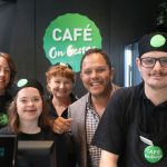 Alastair Mcleod with STEPS Pathways students in STEPS Cafe on George