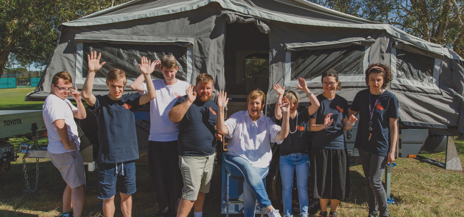 Students in front of camper trailer